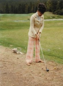 Carole Bealer golfing in Banff, Alberta