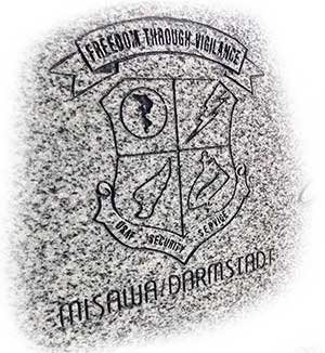 US Air Force Security Service logo on granite.